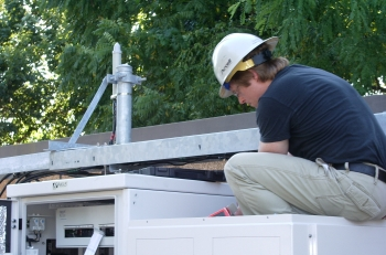 Purcell Systems technical field-expert assists with installation of network infrastructure